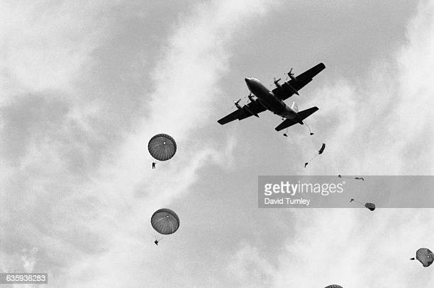 American World War II veteran paratroopers jump from a plane to commemorate the 50th Anniversary of the Normandy Invasion.