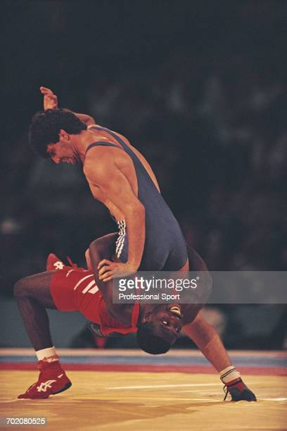 American wrestler Rodney Smith of the United States team competes to defeat Matwai Baranov of Israel to win the bronze medal in the Men's GrecoRoman...