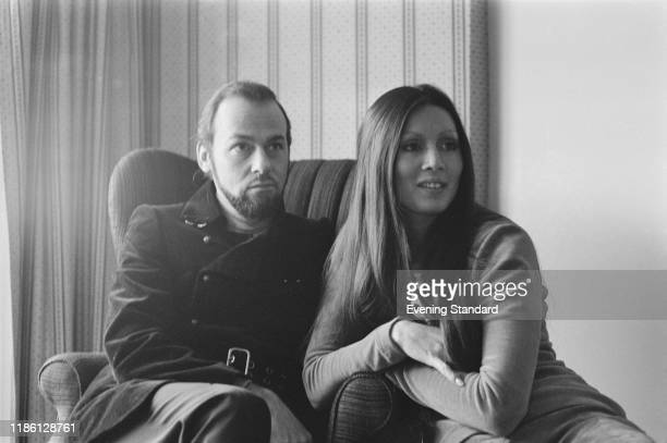 American writer actor and television host James Lipton seated with his wife Kedakai Turner in London on 16th November 1970