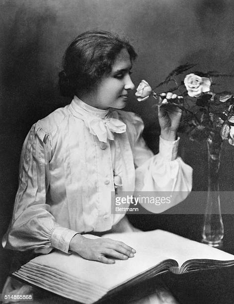 Famous American writer and lecturer Helen Keller takes time to smell a rose Due to illness Keller suffered loss of sight and hearing at the age of 19...