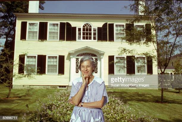 American writer and theater critic Mary McCarthy stands in front of her summer home in Castine, Maine, 1980s. McCarthy was known for her wit,...