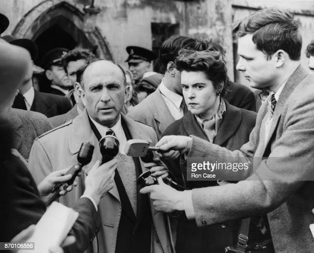 American writer and theatre critic Calvin Hoffman makes a statement to the press after the opening of the tomb of Sir Thomas Walsingham at St...