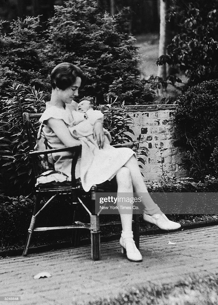 American writer Anne Morrow Lindbergh (1906 - 2001) cradling her infant son, Charles Augustus Lindbergh Jr, on the Morrow estate, Englewood, New Jersey. Two years later the baby was kidnapped and murdered in one of the most publicized criminal trials in history.