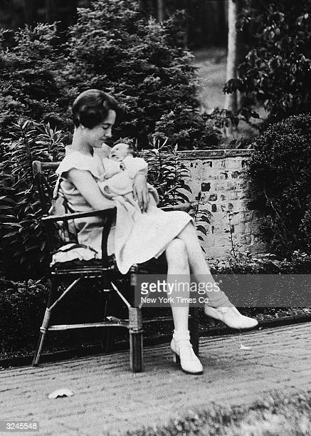American writer Anne Morrow Lindbergh cradling her infant son Charles Augustus Lindbergh Jr on the Morrow estate Englewood New Jersey Two years later...
