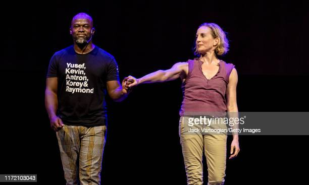 American writer, composer, and spoken word artist Marc Bamuthi Joseph and dancer Wendy Whelan take a bow, after their performance of an excerpt from...