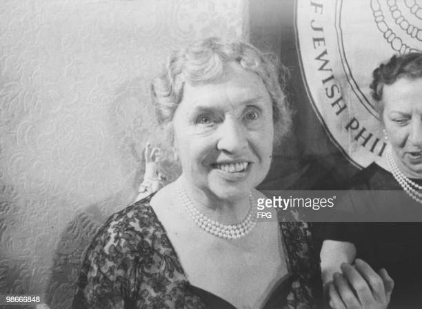 American writer, educator and advocate for the disabled Helen Keller , at a reception in New York, where she was named 'Woman of the Years' by the...