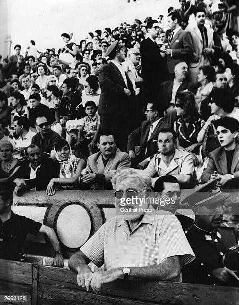 American writer Ernest Hemingway at a Spanish bull-fight in Madrid.