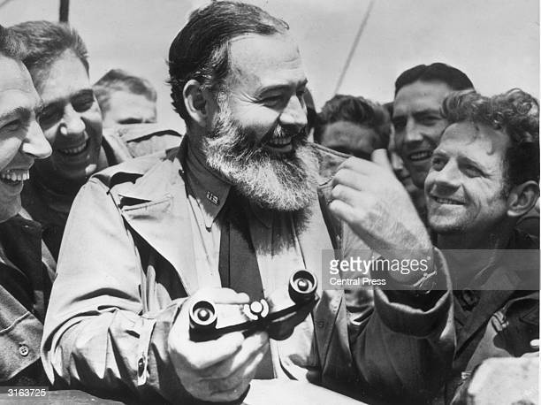 American writer Ernest Hemingway travelling with US soldiers, in his capacity as war correspondent, on their way to Normandy for the D-Day landings.