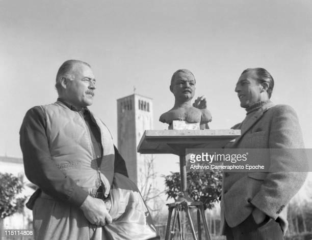 American writer Ernest Hemingway wearing a hunter waistcoat posing for the sculptor Toni Lucarda preparing a bust sculpture in Torcello a belltower...