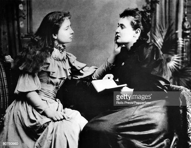 Personalities circa 1900 American writer Helen Keller who became deaf and blind at 19 months pictured as she feels the face of her teacher Anne...
