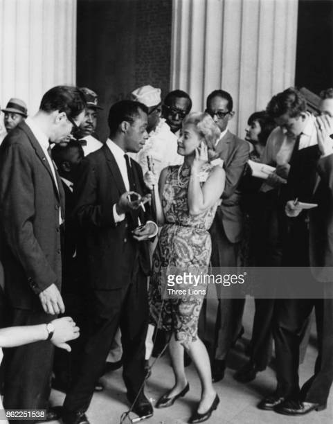 American writer James Baldwin is interviewed by the media in front of the Lincoln Memorial during the March on Washington Washington DC 1963