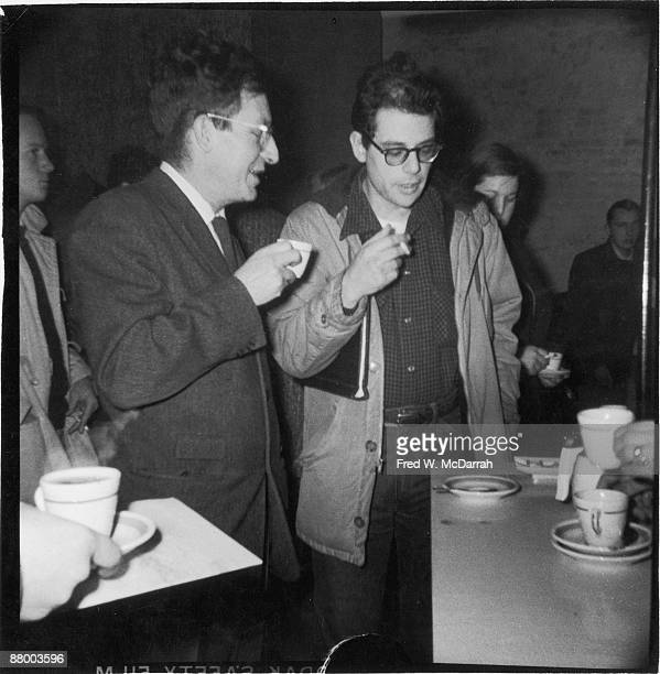 American writer Paul Goodman speaks with poet Allen Ginsberg in the lobby of the Living Theatre New York New York January 26 1959