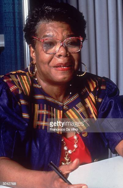 American writer, poet, performer and director Maya Angelou speaks while holding paper and pen.