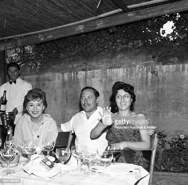 American writer Tennessee Williams visiting at the restaurant Italian actresses Giulietta Masina and Anna Magnani on the set of the film and the Wild...