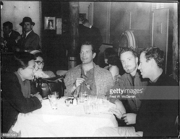 American writers Albert Saijo Jack Kerouac and Lew Welch sit with soontobe married couple Gloria Schoffel and photographer Fred McDarrah at a table...