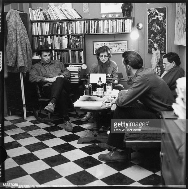 American writers Jack Kerouac Albert Saijo and Lew Welch sit around a low table as they collaborate on a poem which is typed by Gloria Schoffel in...