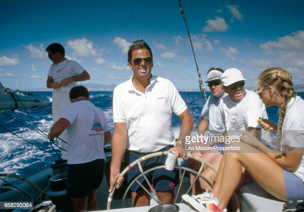 American yachtsman Dennis Conner at the helm of Stars Stripes off the coast of Hawaii circa 1986