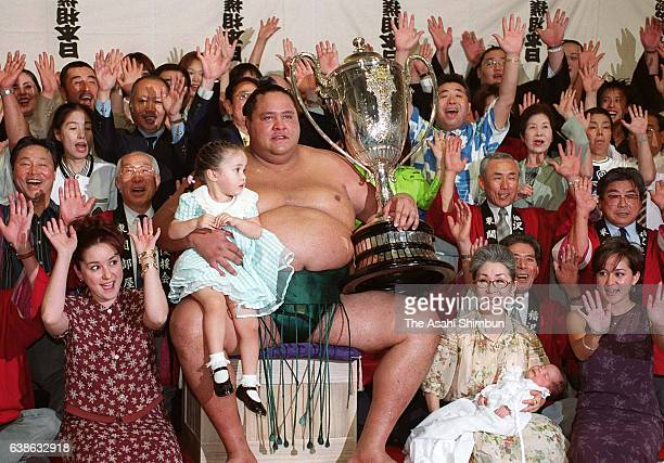 American yokozuna Akebono celebrates winning the tournament with his family and supporters on day fifteen of the Grand Sumo Nagoya Tournament on July...