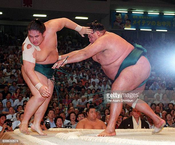 American yokozuna Akebono pushes ozeki Miyabiyama out of the ring to win the tournament on day thirteen of the Grand Sumo Nagoya Tournament at Aichi...