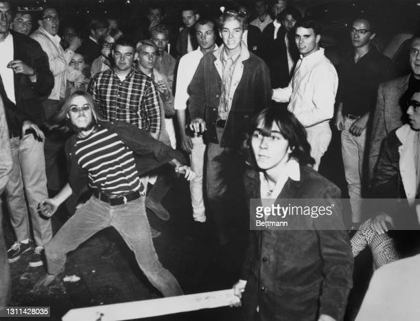 American youths, one armed with a club in the foreground, during one of the Sunset Strip curfew riots, on the Sunset Strip in West Hollywood,...