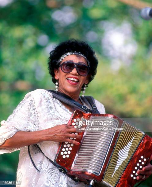 American Zydeco musician Queen Ida plays accordion on Central Park's SummerStage, New York, New York, June 25, 1994.