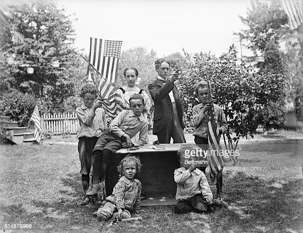 Family group with pistols and flags ready for 4th of July celebration Photograph 1880's