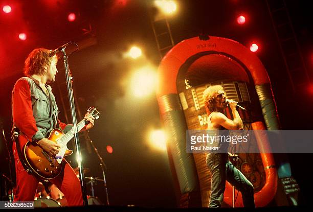 Americanbased rock band Foreigner performs onstage at the Rosemont Horizon Rosemont Illinois November 8 1981 Pictured are from left Mick Jones on...
