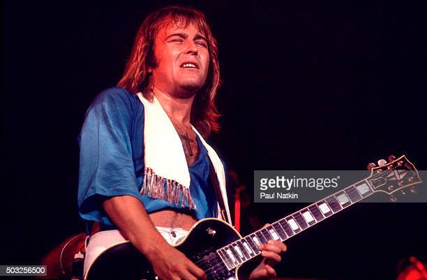 Americanbased rock band Foreigner performs onstage at the Uptown Theater Chicago Illinois September 30 1977 Pictured is Mick Jones on guitar