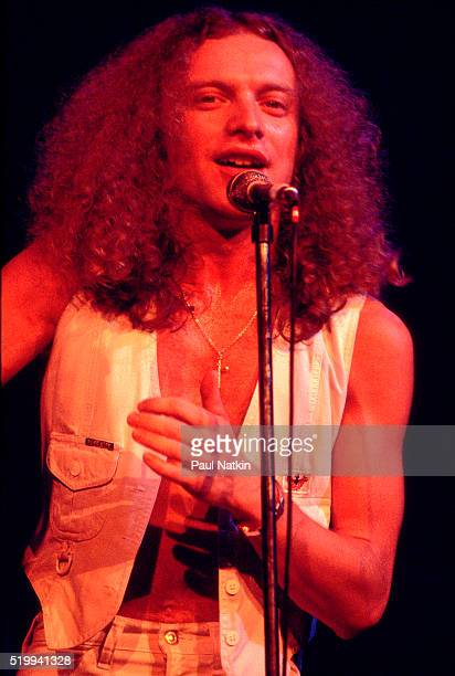 Americanbased rock band Foreigner performs onstage at the Uptown Theater Chicago Illinois September 30 1977 Pictured is vocalist Lou Gramm