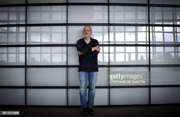American-born British film director Terry Gilliam poses during a photo session on March 13, 2018 at the Opera Bastille in Paris.