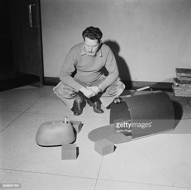 Americanborn British neurophysiologist and cybernetics pioneer Grey Walter and one of his threewheeled electromechanical tortoise robots November...