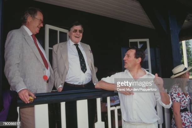 Americanborn British philanthropist Sir Paul Getty talking to former English cricketer Richard Hutton at the first match to be played at Getty's new...