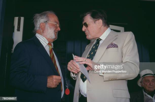 Americanborn British philanthropist Sir Paul Getty talking to former England wicketkeeper Godfrey Evans at the first match to be played at Getty's...