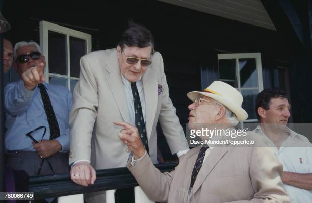 Americanborn British philanthropist Sir Paul Getty talking to sports journalist and cricket commentator E W 'Jim' Swanton at the first match to be...