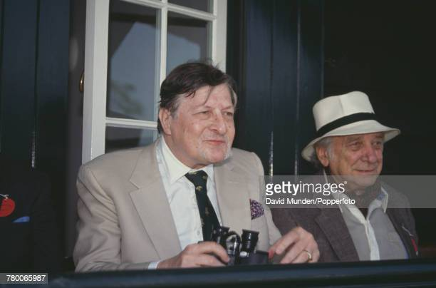 Americanborn British philanthropist Sir Paul Getty watching the first match to be played at the new cricket ground on his Wormsley Park estate in...