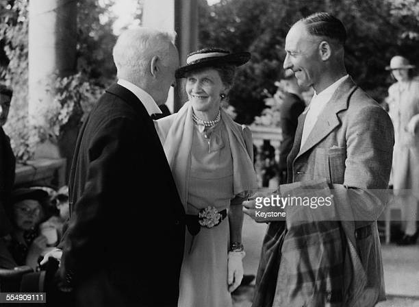 American-born English socialite and politician Nancy Astor, Viscountess Astor with guests at a party given for House Of Commons staff, at her home,...