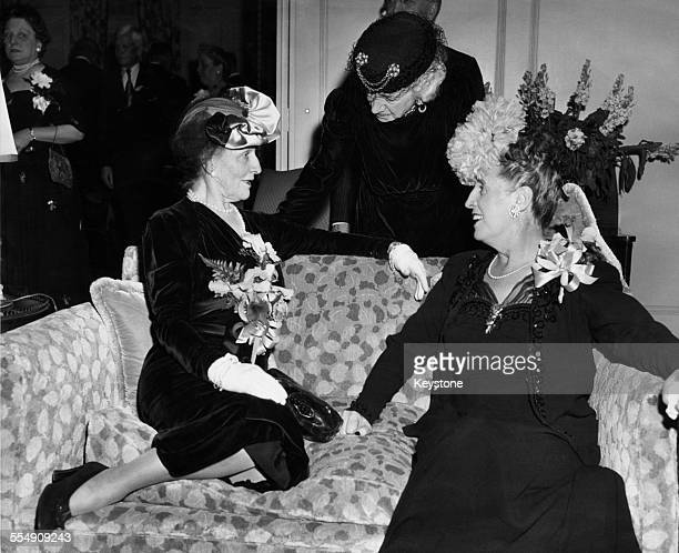 American-born English socialite and politician Nancy Astor, Viscountess Astor , with Mrs John Shaw and Mrs Herbert R. O'Connor, at a reception given...