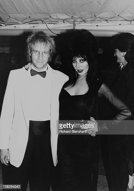 Americanborn French actor Christopher Lambert with American actress Cassandra Peterson who is in character as Elvira Mistress of the Dark at the...