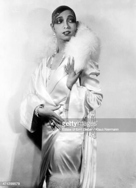 Americanborn French dancer singer and actress Josephine Baker wearing a satin outfit with fur trim Hamburg 1925