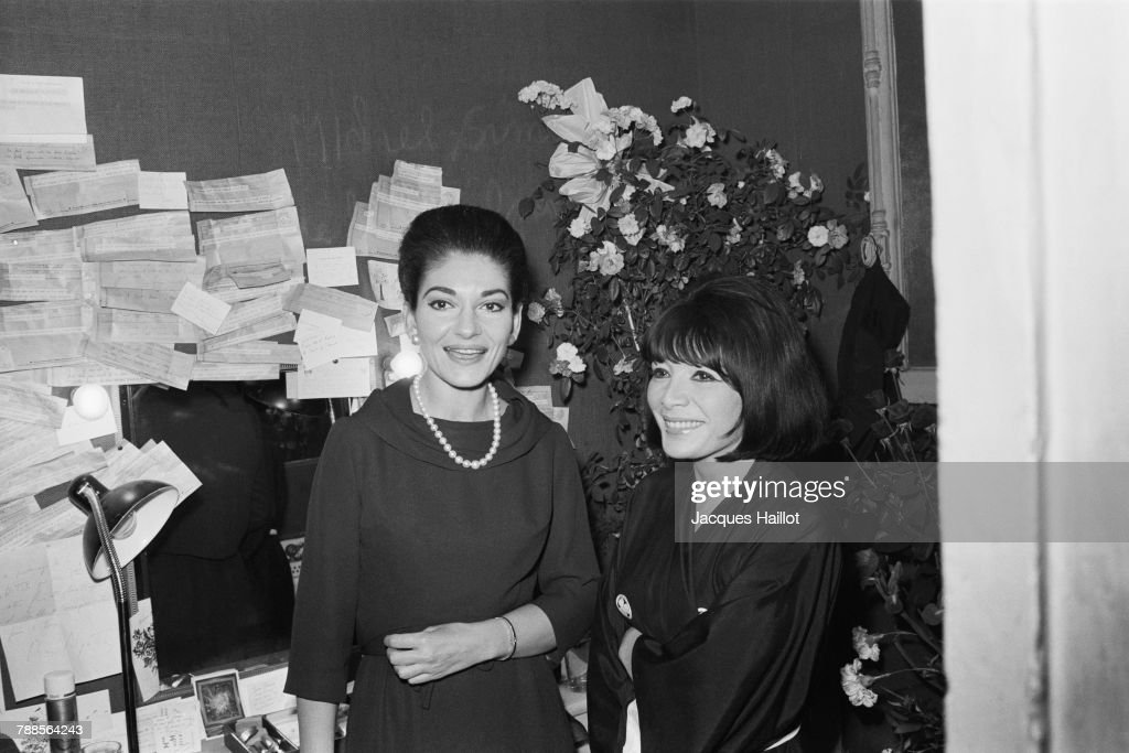 American-born Greek soprano Maria Callas with French singer and actress Juliette Greco in a dressing room at the Olympia music hall.
