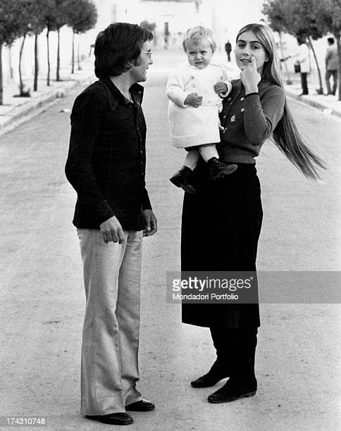 Americanborn Italian singer Romina Power carrying her daughter Ylenia Carrisi Italian singer Al Bano looks at them Cellino San Marco 1970s