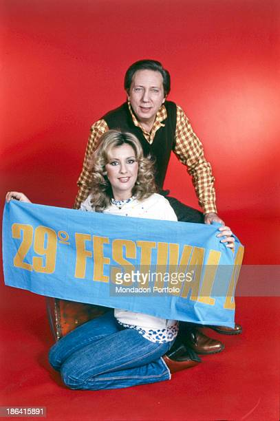 Americanborn Italian TV host Mike Bongiorno and Italian actress and model Anna Maria Rizzoli posing with the advertising banner of the 29th Sanremo...