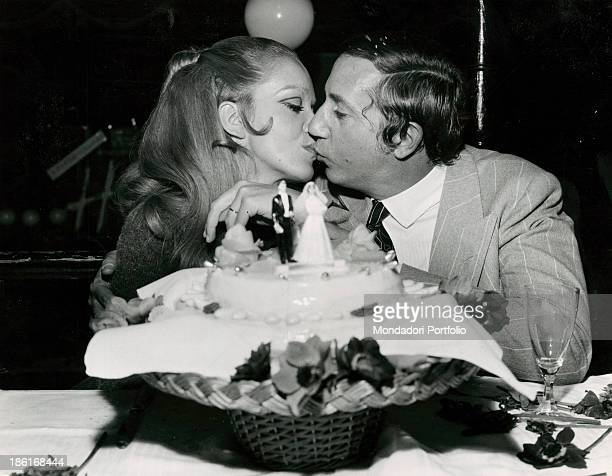 Americanborn Italian TV host Mike Bongiorno kissing Italian journalist Annarita Torsello in the day of their wedding Paris 11th October 1968