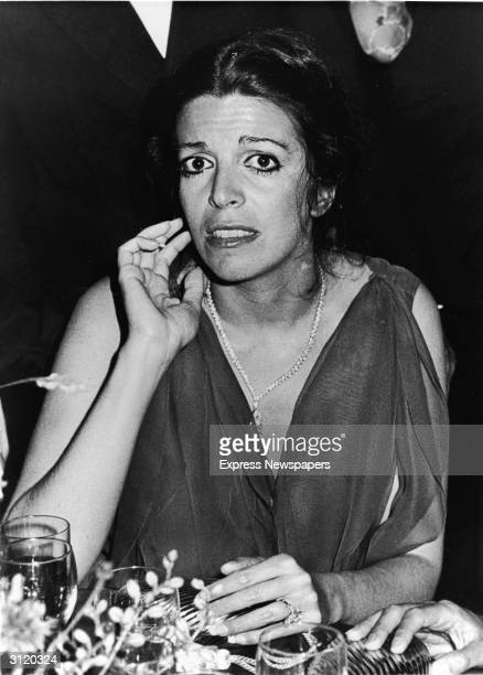 Americanborn shipping heiress Christina Onassis is seated at a dinner table at a formal event early 1980s