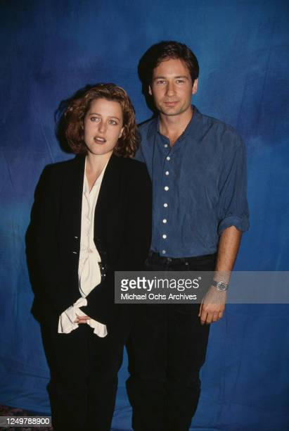 American-British actress Gillian Anderson, wearing a black trouser suit with a white blouse, and America actor David Duchovny, wearing a blue shirt,...