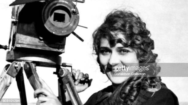 Film pioneer Alice GuyBlache poses for a portrait with a movie camera in circa 1910 in New York