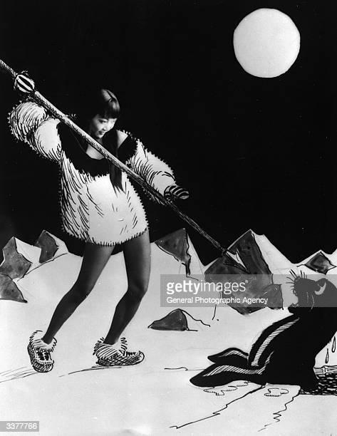 AmericanChinese actress Anna May Wong aiming a spear at a cartoon sea lion