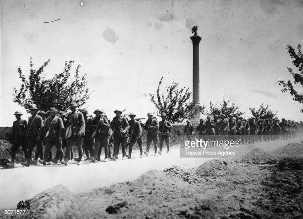 Americans on the march near Chateau Thiery, the scene of their successful attack in the decisive second battle of the Marne.