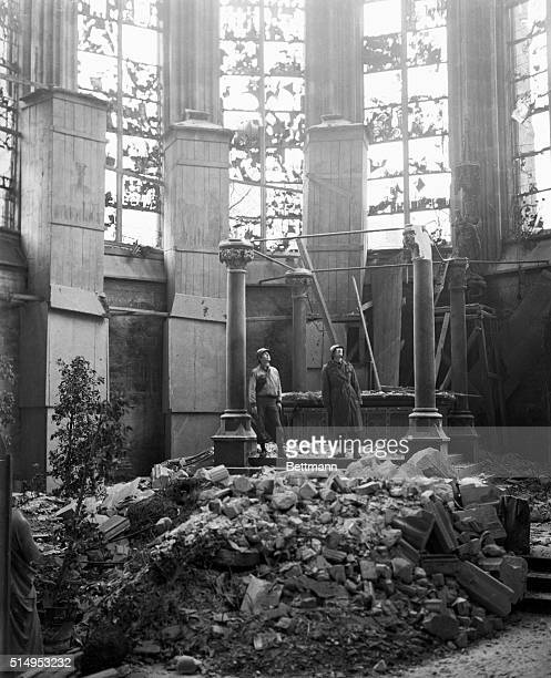 Americans stand on the site of the main altar in historic Aachen Cathedral The edifice was damaged in the bombardments that featured the battle for...