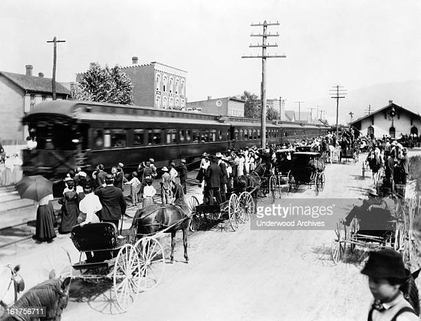 Americans wait to pay tribute to the assassinated President McKinley's funeral train on its way to Canton Ohio 1901